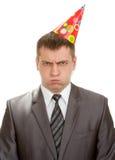 Trauriger Geburtstaggeschäftsmann im Hut Lizenzfreies Stockfoto