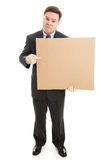 Trauriger Geschäftsmann mit Pappzeichen Stockbild