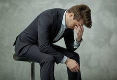 Trauriger Geschäftsmann ohne die Leistung Stockfotografie