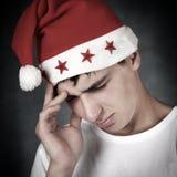Trauriger Jugendlicher in Santa Hat Stockfoto