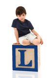 Trauriger Junge auf Zeichen L Stockbilder