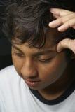 Trauriger junger asiatischer Mann Lizenzfreie Stockfotos