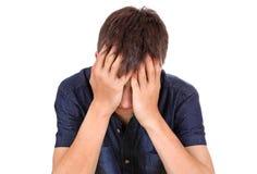 Trauriger junger Mann stockbild