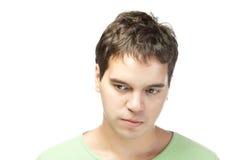 Trauriger junger Mann getrennt auf weißem Hintergrund stockfotografie