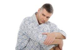 Trauriger Mann in den Pyjamas. Lizenzfreie Stockfotografie