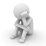 Trauriger Mann, der auf Weiß sitzt Stockfoto