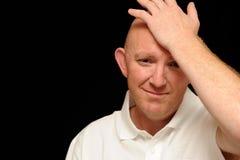 Trauriger Mann mit der Hand auf Kopf Lizenzfreies Stockbild
