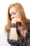 Trauriges blondes junges Mädchen Stockfoto
