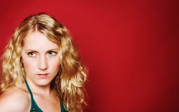 Trauriges blondes Mädchen Lizenzfreies Stockfoto