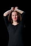 Trauriges braunes Haarschreien der jungen Frauen Lizenzfreies Stockfoto