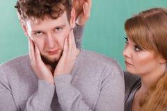 Trauriges deprimiertes Paarporträt Lizenzfreies Stockfoto