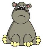 Trauriges Flusspferd sitzt Stockfotos
