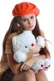 Trauriges Mädchen mit weißem Bären Stockbild
