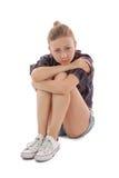 Trauriges Mädchensitzen Lizenzfreie Stockfotografie