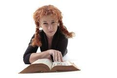 Trauriges Mädchen mit Buch Stockbild