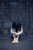 Trauriges und deprimiertes kleines Mädchen Stockbild