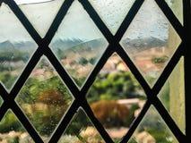 A través de la ventana cruzada fotos de archivo libres de regalías