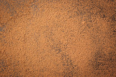 Trava kakaopulver, bakgrund av en torr pulverkakaobrunt, hög av Arkivfoton