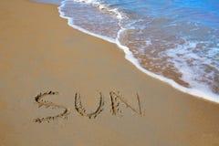Travail écrit par charme de Sun en sable d'une plage Photo libre de droits
