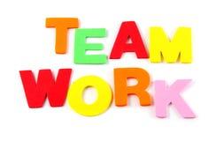Travail d'équipe dans les lettres colorées sur le blanc Photo libre de droits