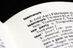 Travail d'équipe en dictionnaire Photos stock