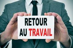 Travail d'Au de Retour, de nouveau au travail en français Image stock