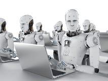 Travail de robots sur l'ordinateur portable Photo stock