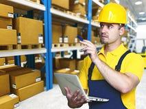 Travail de travail dans l'entrepôt Images stock