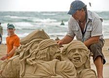 Travailler à la plage Photographie stock libre de droits