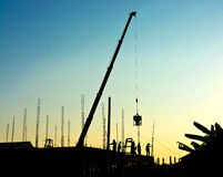 Travailler de travailleurs de la construction Photos stock