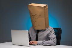 Travailler sur l'ordinateur portable Photo libre de droits