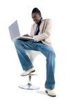 Travailler sur l'ordinateur portatif Image libre de droits