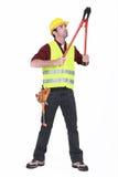 Travailleur à l'aide des coupeurs de boulon Images stock
