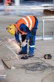 Travailleur brouillé au chantier de construction Photographie stock