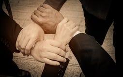 Travailleur d'affaires avec des mains ensemble Images stock