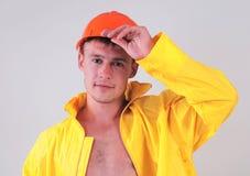 Travailleur dans l'uniforme jaune Images libres de droits