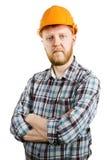 Travailleur dans la chemise orange de casque et de plaid photographie stock