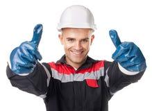Travailleur dans les gants protecteurs renonçant au pouce Photos libres de droits