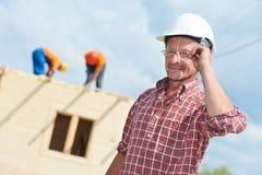 Travailleur de constructeur de construction au site Photo libre de droits