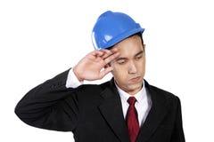 Travailleur de la construction épuisé d'isolement Image stock