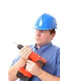 Travailleur de la construction avec la foreuse images stock