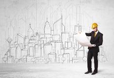 Travailleur de la construction avec le fond de paysage urbain Photo stock