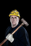 Travailleur de la construction avec le marteau de forgeron Images stock