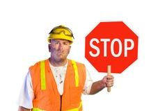 Travailleur de la construction avec le signe d'arrêt Image stock