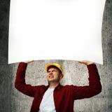 Travailleur de la construction avec le tableau blanc Photo stock