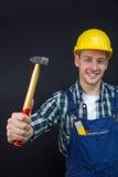 Travailleur de la construction avec un marteau Photographie stock libre de droits