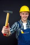 Travailleur de la construction avec un marteau Photo stock