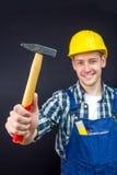 Travailleur de la construction avec un marteau Photos stock