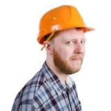 Travailleur de la construction dans le casque orange de construction photo stock