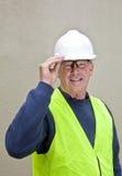 Travailleur de la construction dans le vêtement correct de sécurité Photo stock